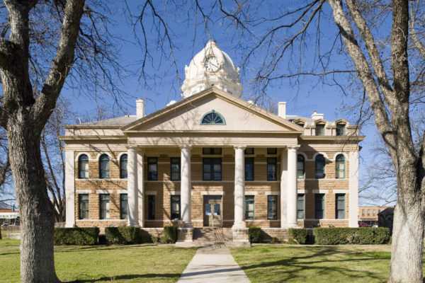 A photo of the Mason County Courthouse in Mason, Texas.  Designed by E.H. Hosford And Co., the Mason courthouse was built in 1909.  The granite Mason County Courthouse, a Beaux-Arts structure and the county's third courthouse, is a Texas Historic Landmark and is included in the Mason Historic District, which is listed on the National Register of Historic Places.  This photo © Capitolshots Photography, ALL RIGHTS RESERVED.